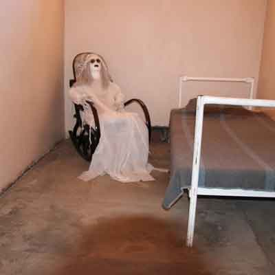 Cell with a dummy dressed in white on a rocking chair