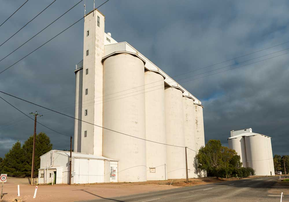 silos against a grey, cloudy sky